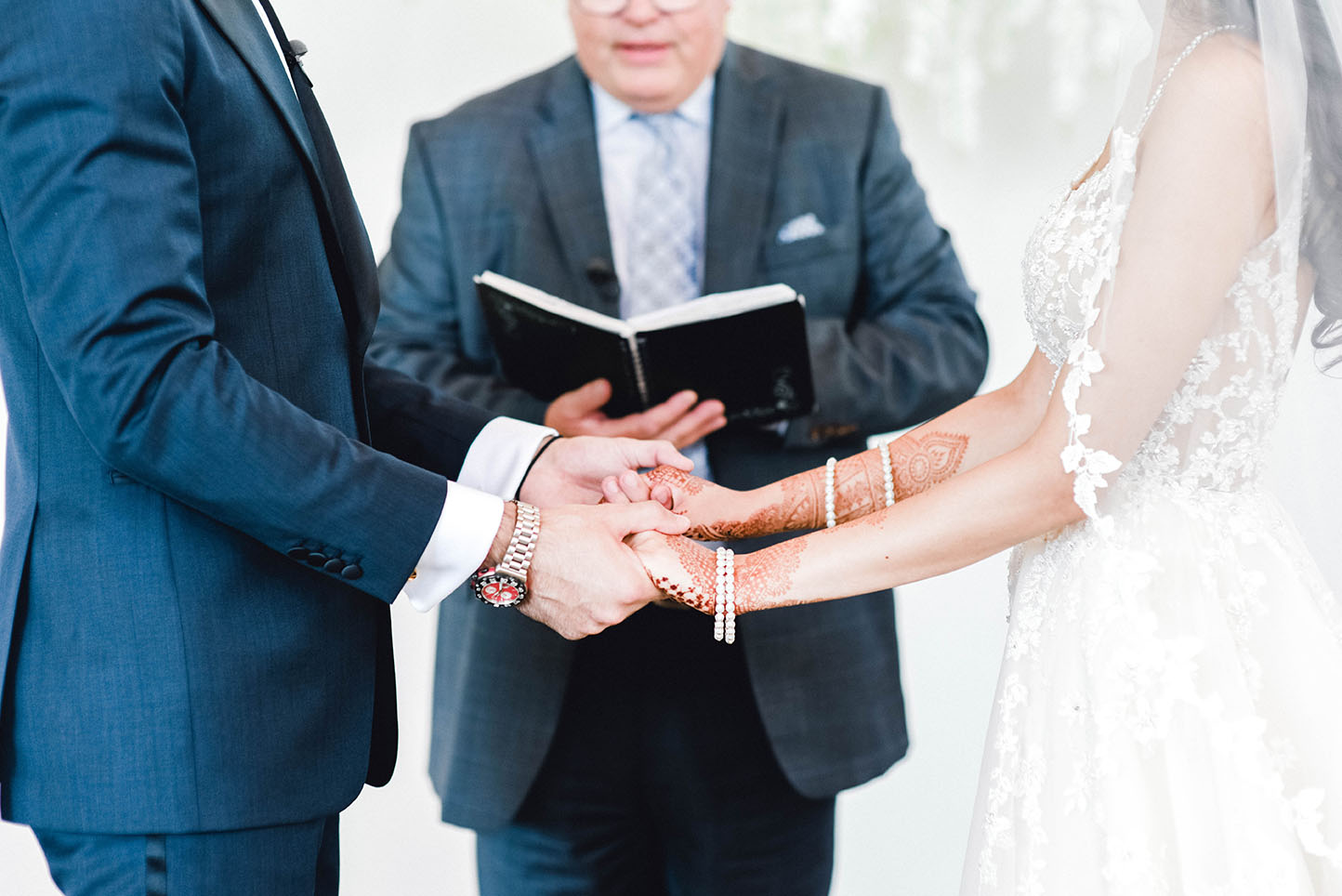 bride and groom hold hands Top wedding photography Toronto